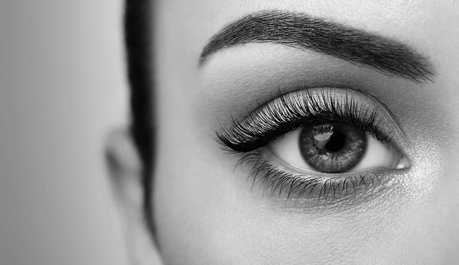 close up shot of woman's eye in black in white