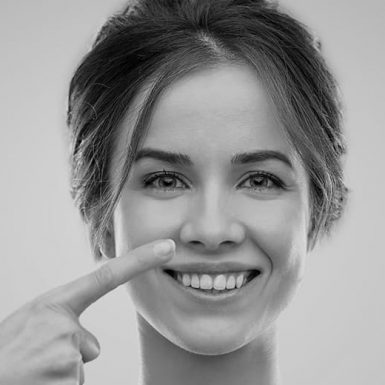 woman pointing to her wide nose