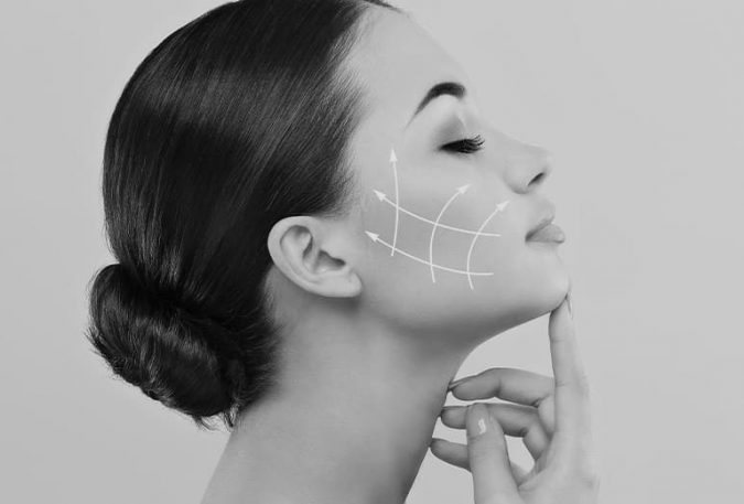 profile view of woman's face with arrows on it